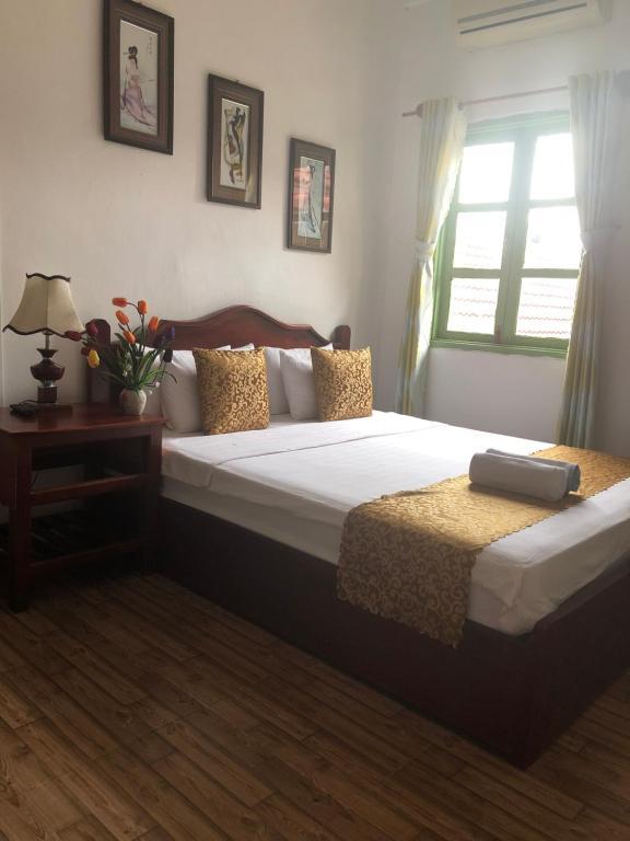 Cama o camas de una habitación en Thavisouk Guesthouse