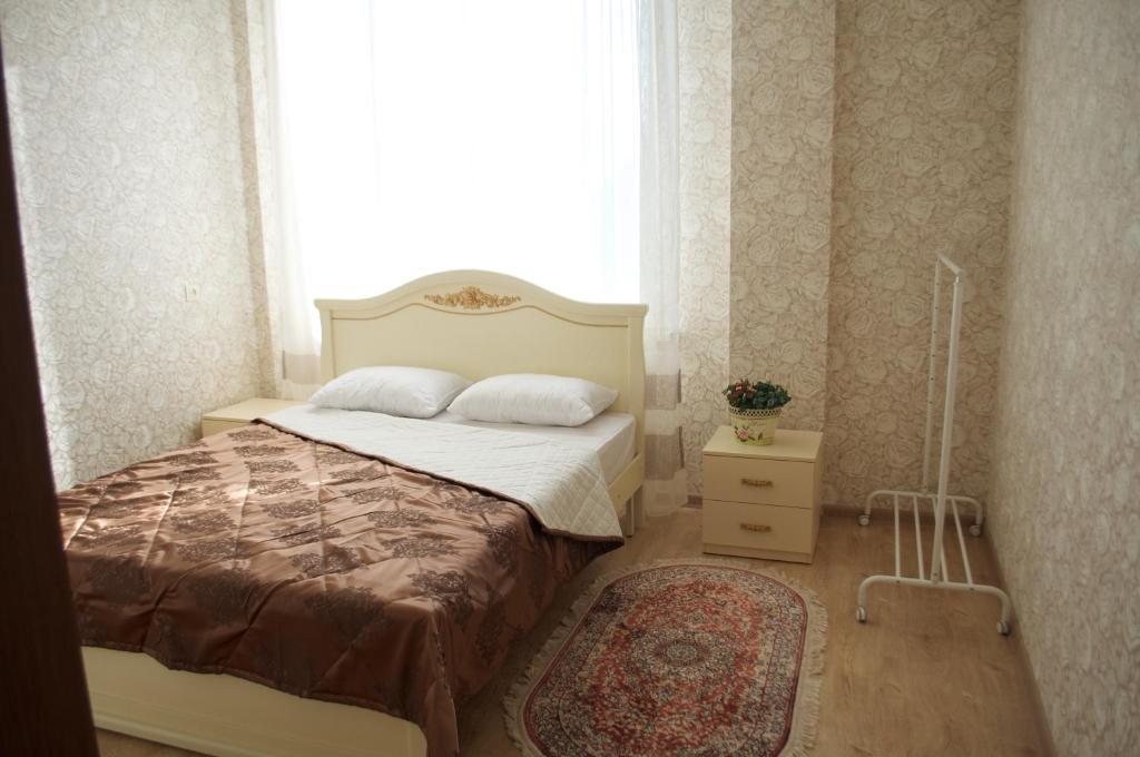 Кровать или кровати в номере Гостиница Белые журавли