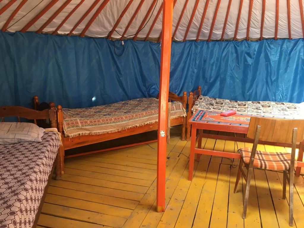A bed or beds in a room at Traveller's Guesthouse