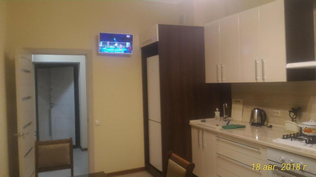 A kitchen or kitchenette at Apartment on Lenina 119a