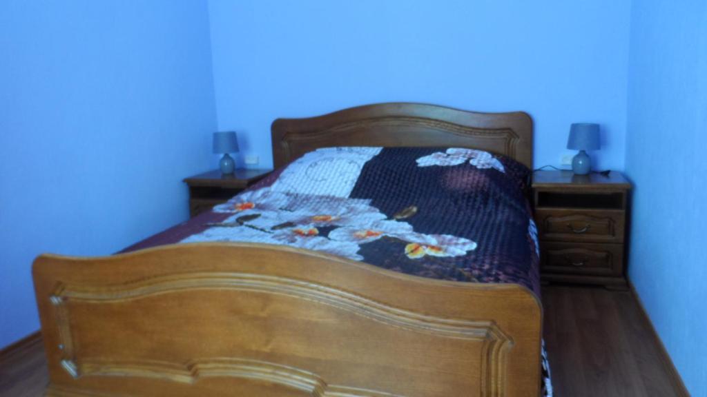 """Кровать или кровати в номере """"Визит"""""""
