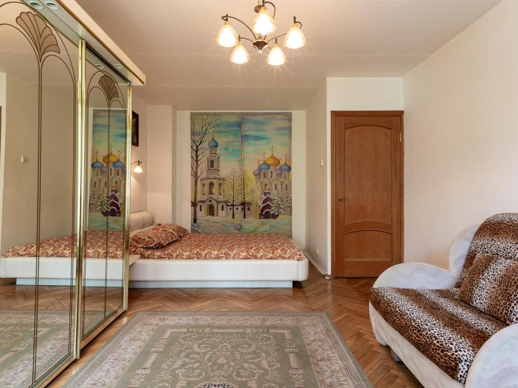 Кровать или кровати в номере Апартаменты на Пресненском Валу