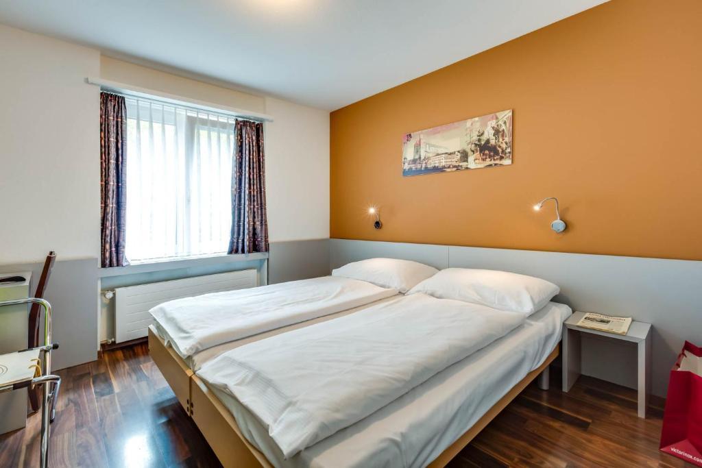 Кровать или кровати в номере Alexander Guesthouse Zurich Old Town