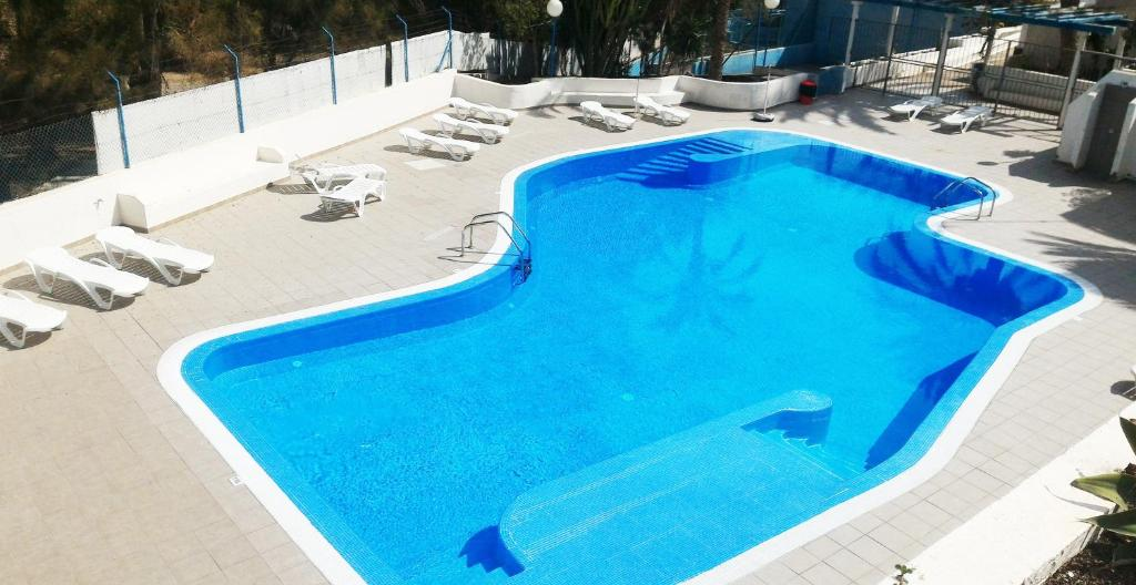 A view of the pool at Bungalows Sonneland Maspalomas or nearby