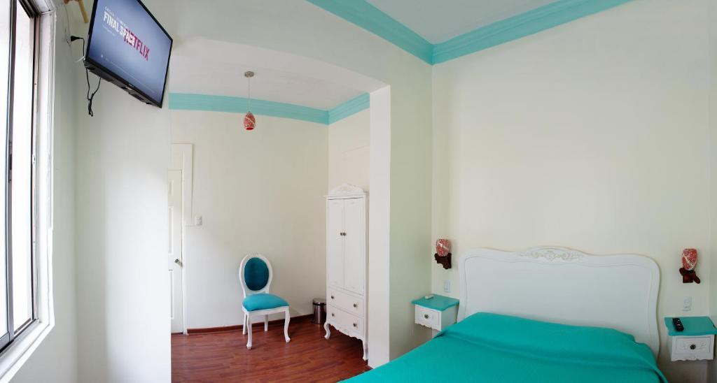 Cama ou camas em um quarto em Hostal Casa Aborigen