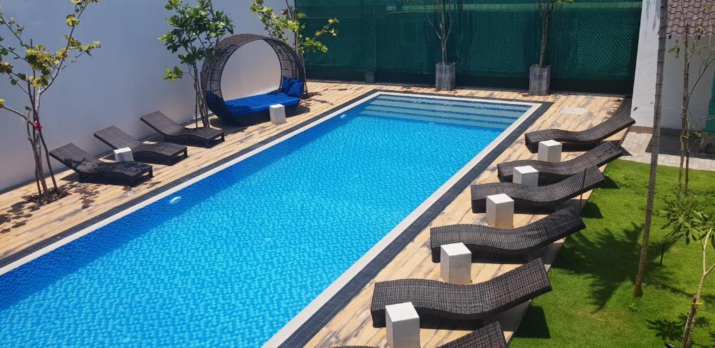 A view of the pool at Cloud 9 Boutique Hotel or nearby