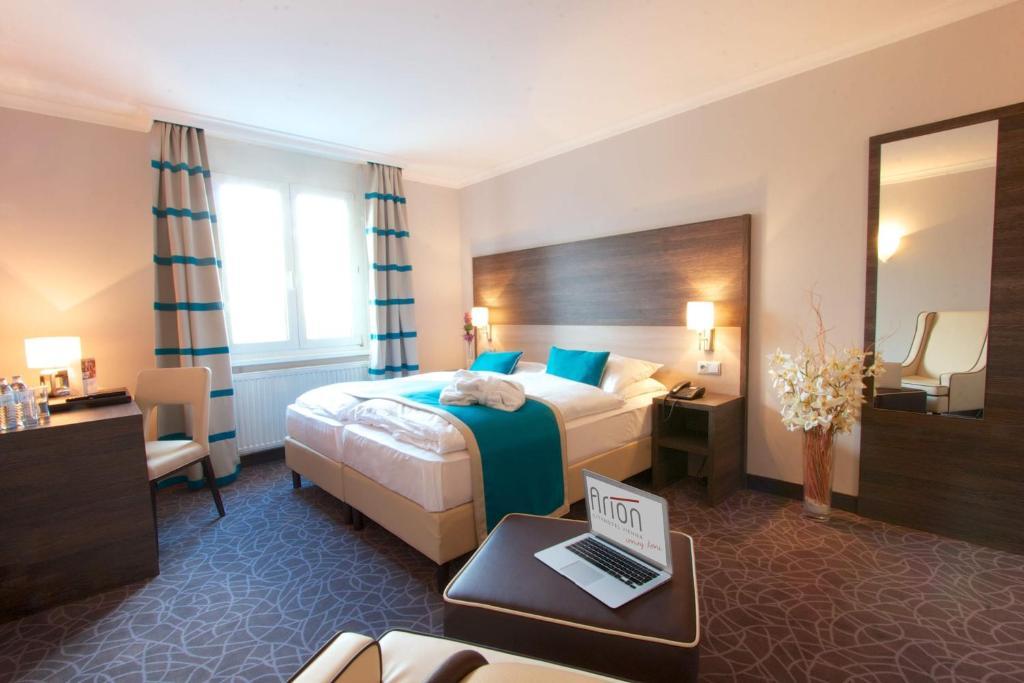 Postel nebo postele na pokoji v ubytování Arion Cityhotel Vienna und Appartements