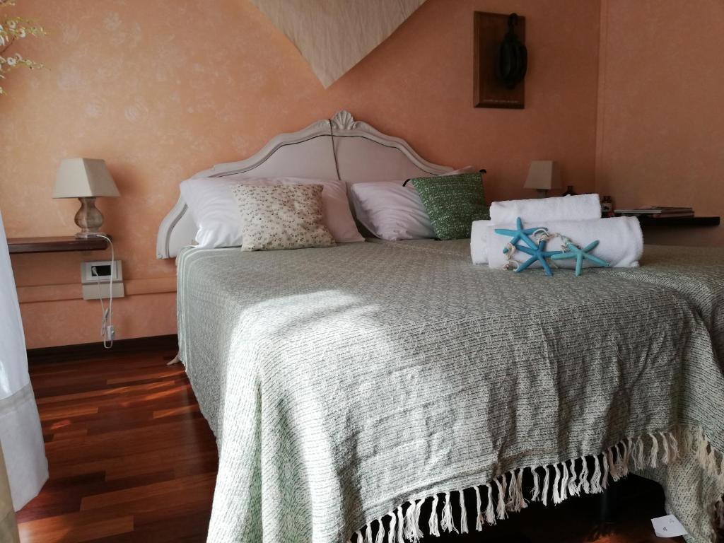 Cama o camas de una habitación en Il Veliero Romantico