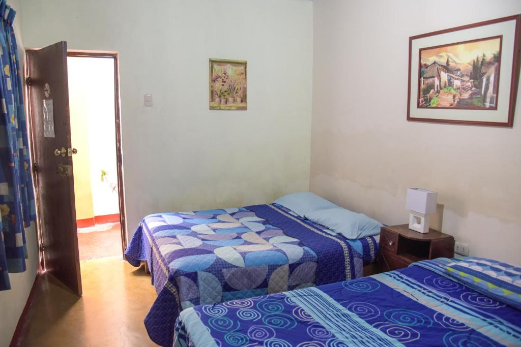 A bed or beds in a room at Brabant Hostal