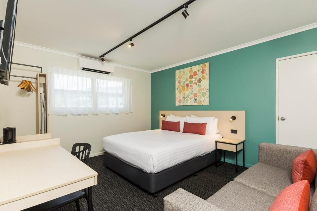A bed or beds in a room at Nightcap At Balaclava Hotel