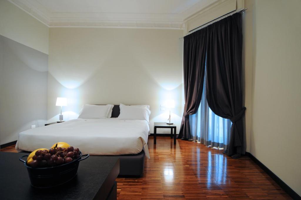 Cama o camas de una habitación en Suitedreams