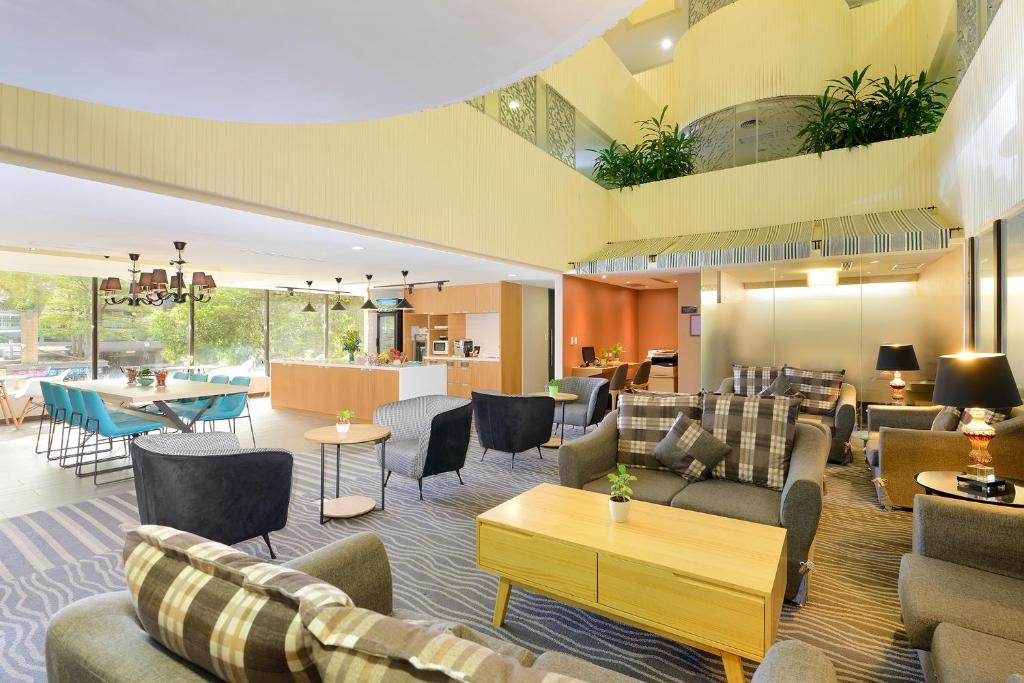 The lounge or bar area at Green Garden Apartments-A