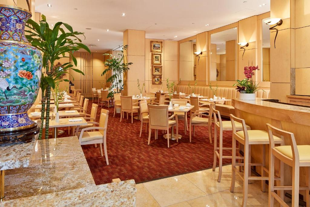 A restaurant or other place to eat at Orchard Garden Hotel