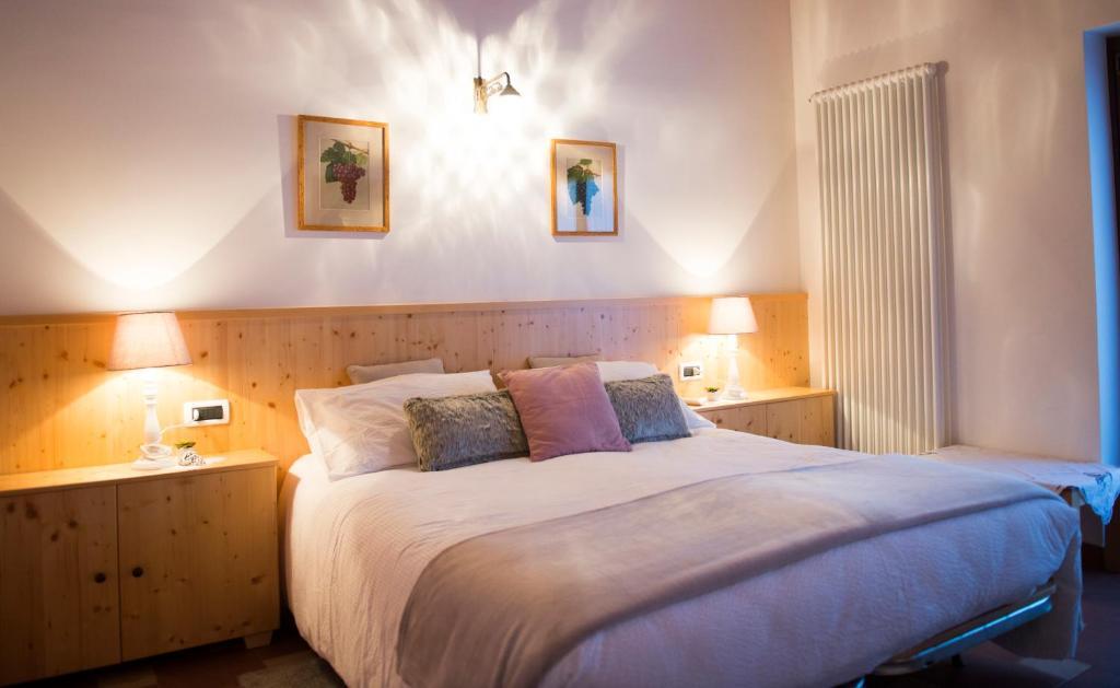 Letto o letti in una camera di Alle Vigne Bed and Breakfast