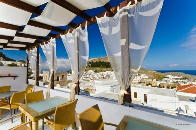 A restaurant or other place to eat at Xenones Lindos