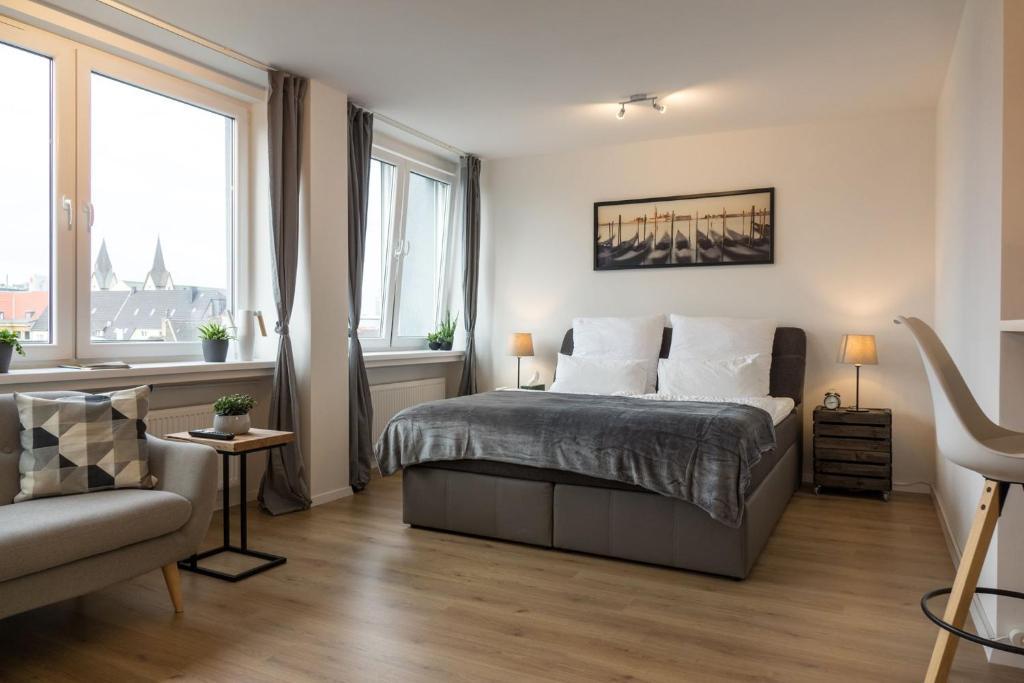 A bed or beds in a room at Business Apartment mit Blick auf die Skyline von Essen
