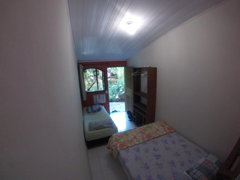 Cama ou camas em um quarto em Pousada Refugio dos Passaros