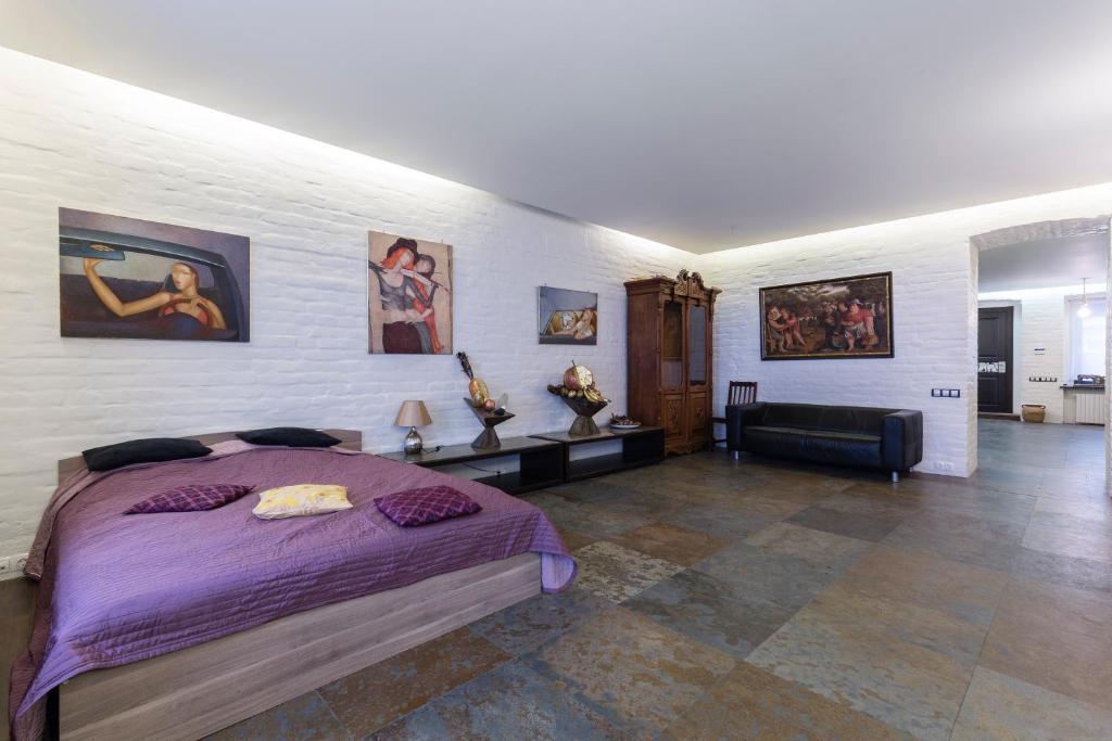 Кровать или кровати в номере Julia Gallery Apartment