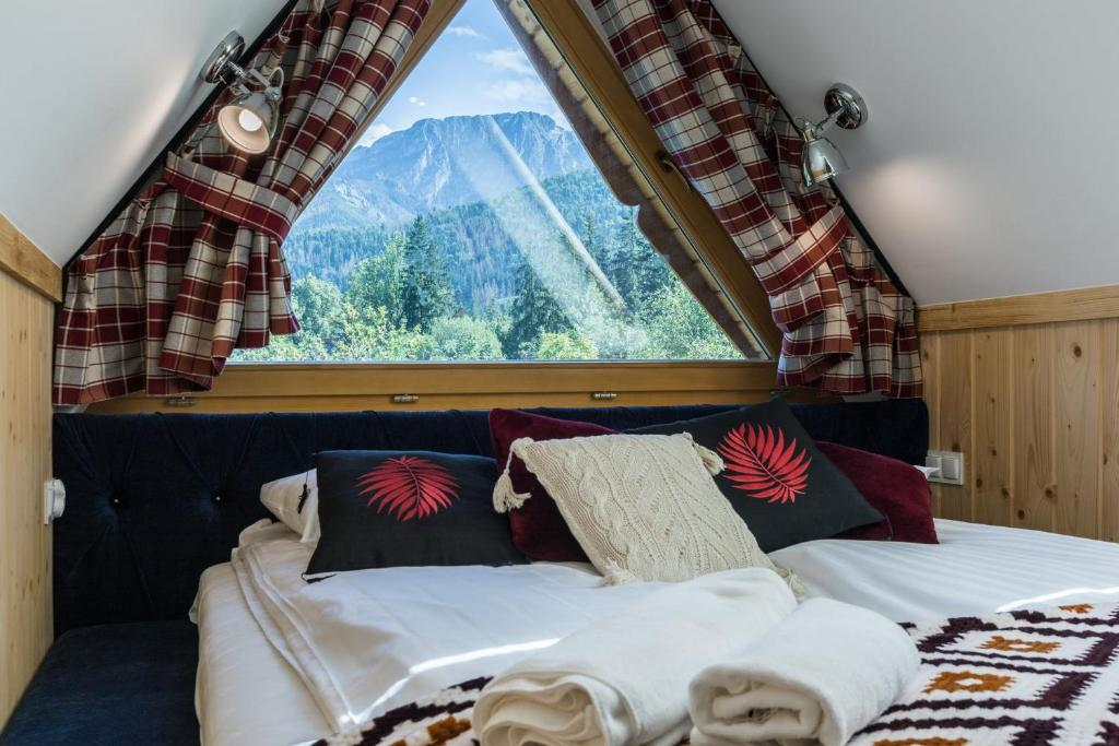 Łóżko lub łóżka w pokoju w obiekcie Rezydencja Sobiczkowa Apartamenty