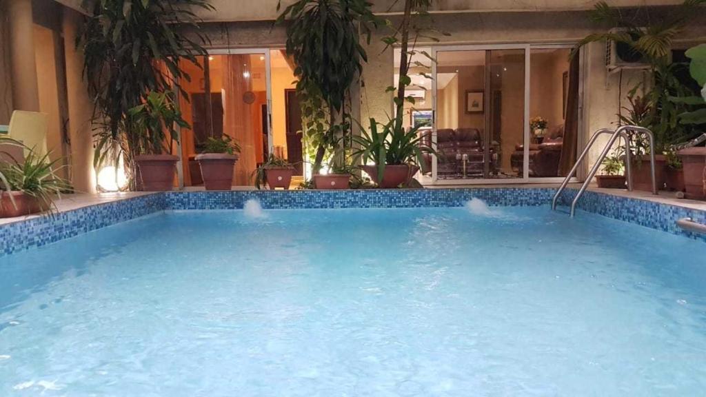 The swimming pool at or near Mukina Inn