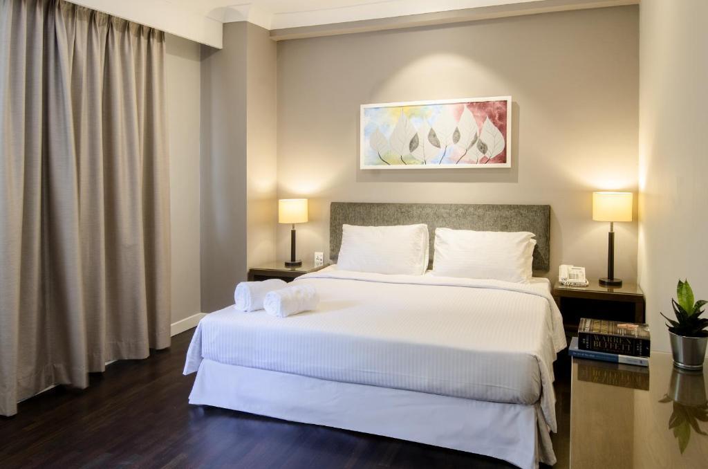 Кровать или кровати в номере The Nomad Serviced Residences Bangsar