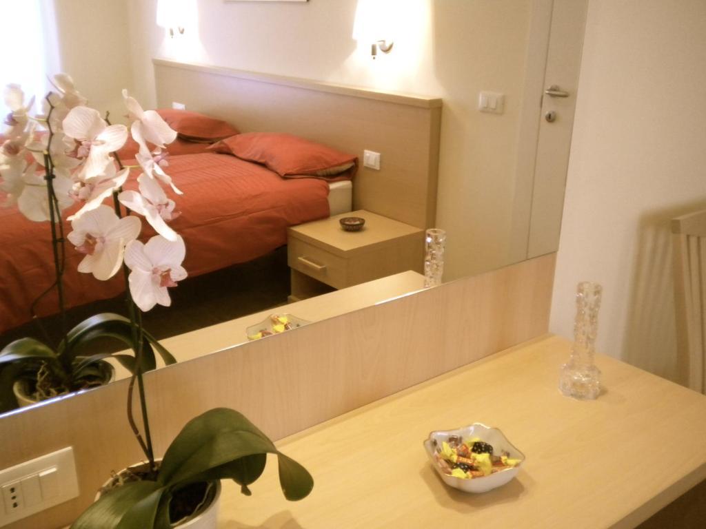 Letto o letti in una camera di Alba Romana B&B
