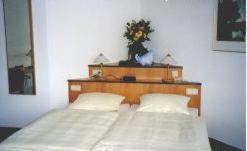 Ein Bett oder Betten in einem Zimmer der Unterkunft Gästehaus Hankhausen