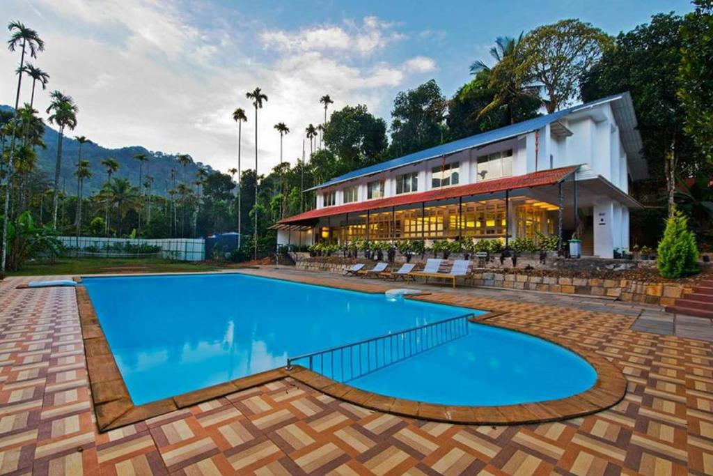 The swimming pool at or near Vythiri Holiday Resort