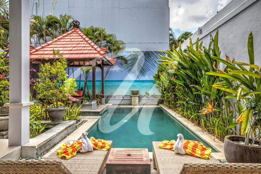 The swimming pool at or near Vila Ultima Bali