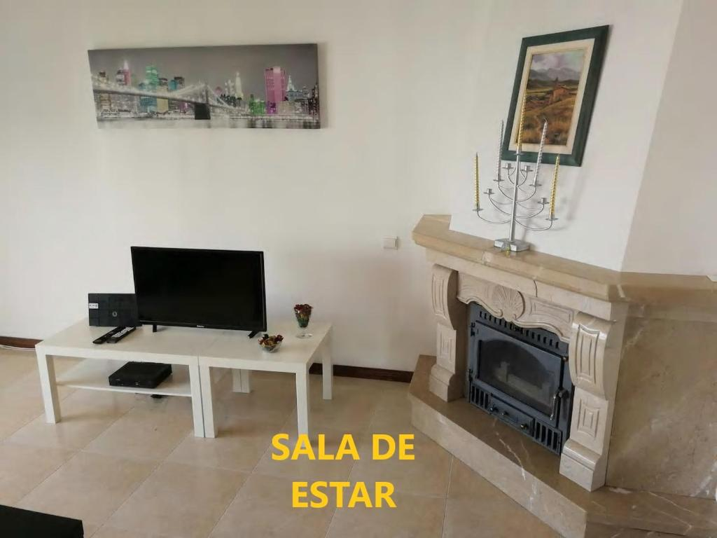 A television and/or entertainment center at Lisbon Odivelas Apartment