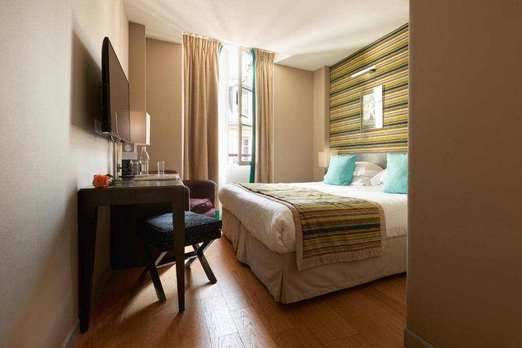 A bed or beds in a room at Le Mathurin Hotel & Spa