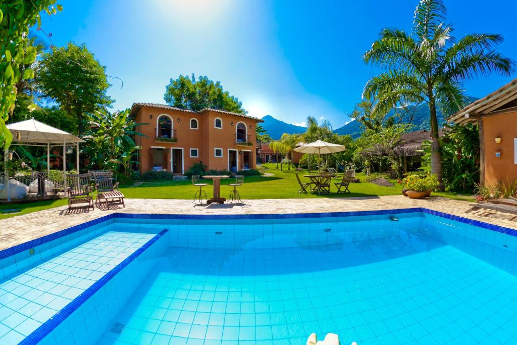 The swimming pool at or near Pousada Terra Madre