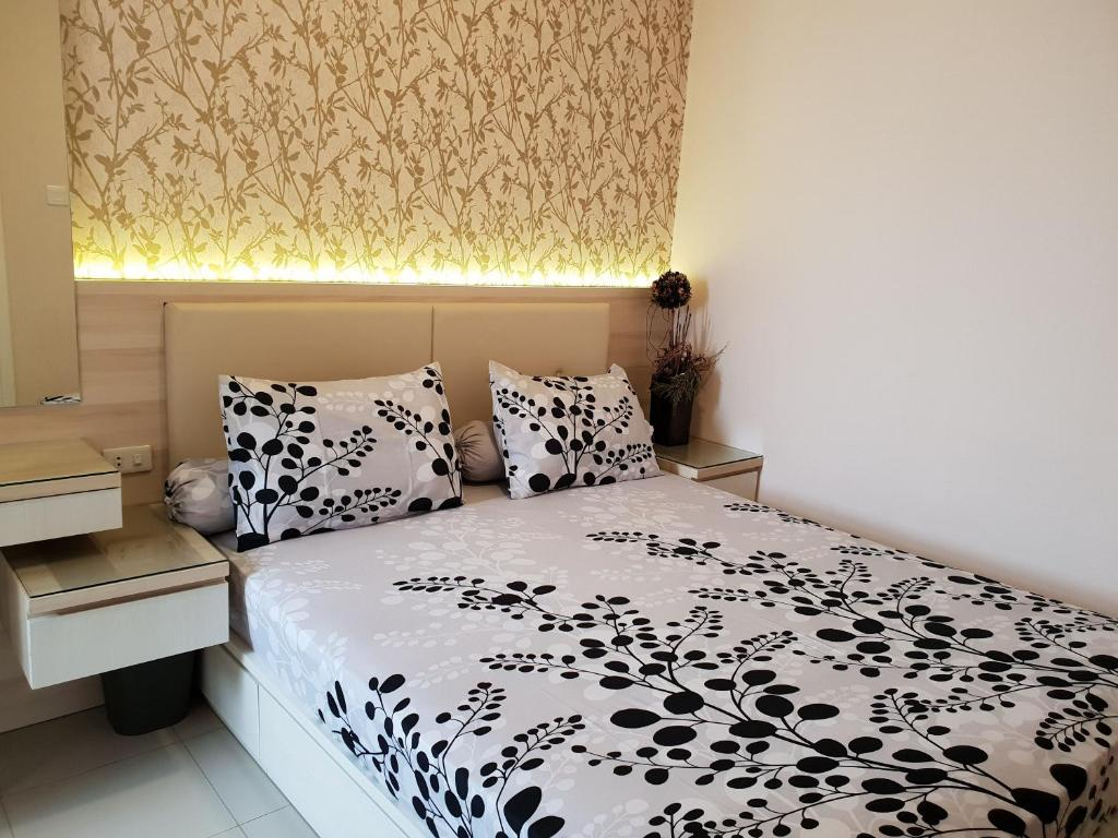 A bed or beds in a room at Beautiful Bandung Residence