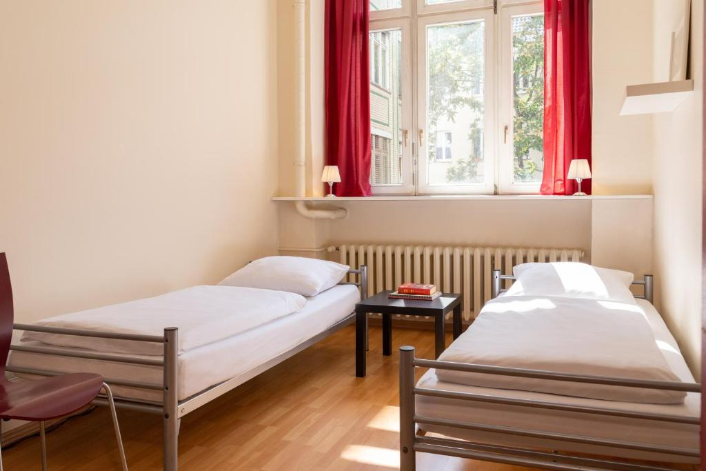 A bed or beds in a room at All In Hostel Berlin