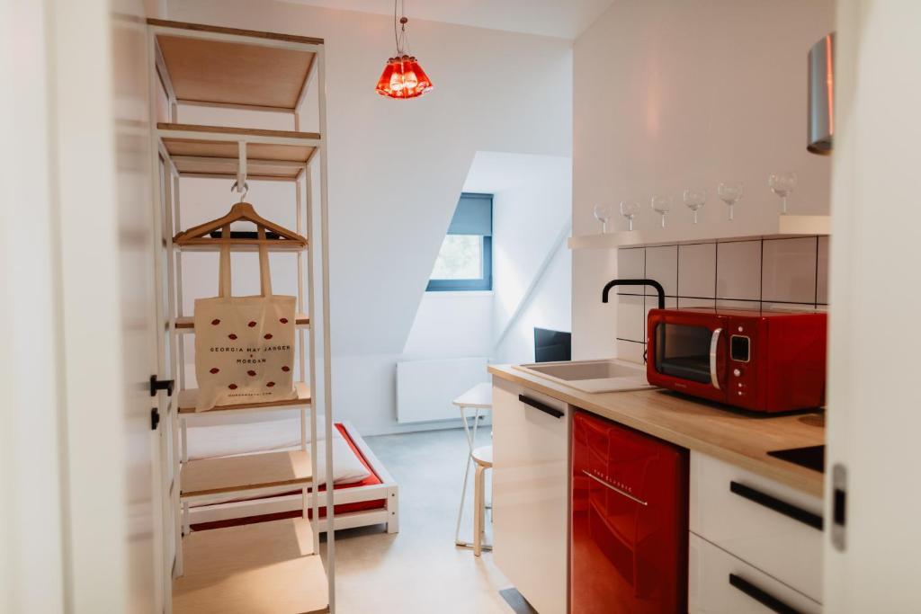 Кухня или мини-кухня в Street Food Possonium Apartments