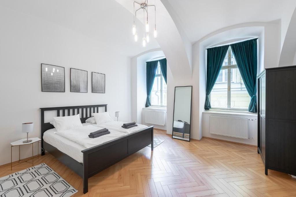 Letto o letti in una camera di 26 Smetanovo nábřeží