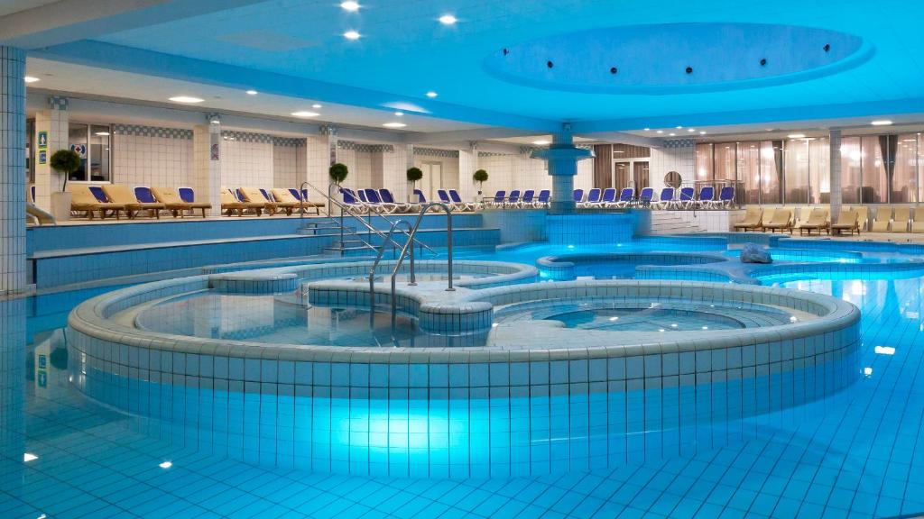 The swimming pool at or near Habakuk Wellness Hotel