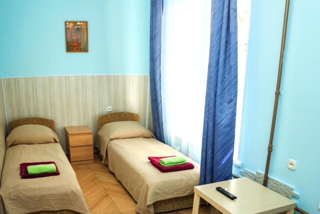 Кровать или кровати в номере Гостевой Дом Old Flat на Жуковского