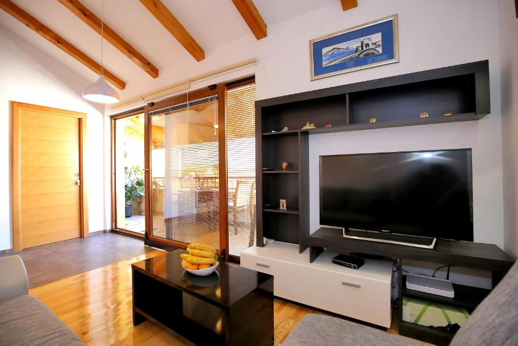 A television and/or entertainment centre at Julijana