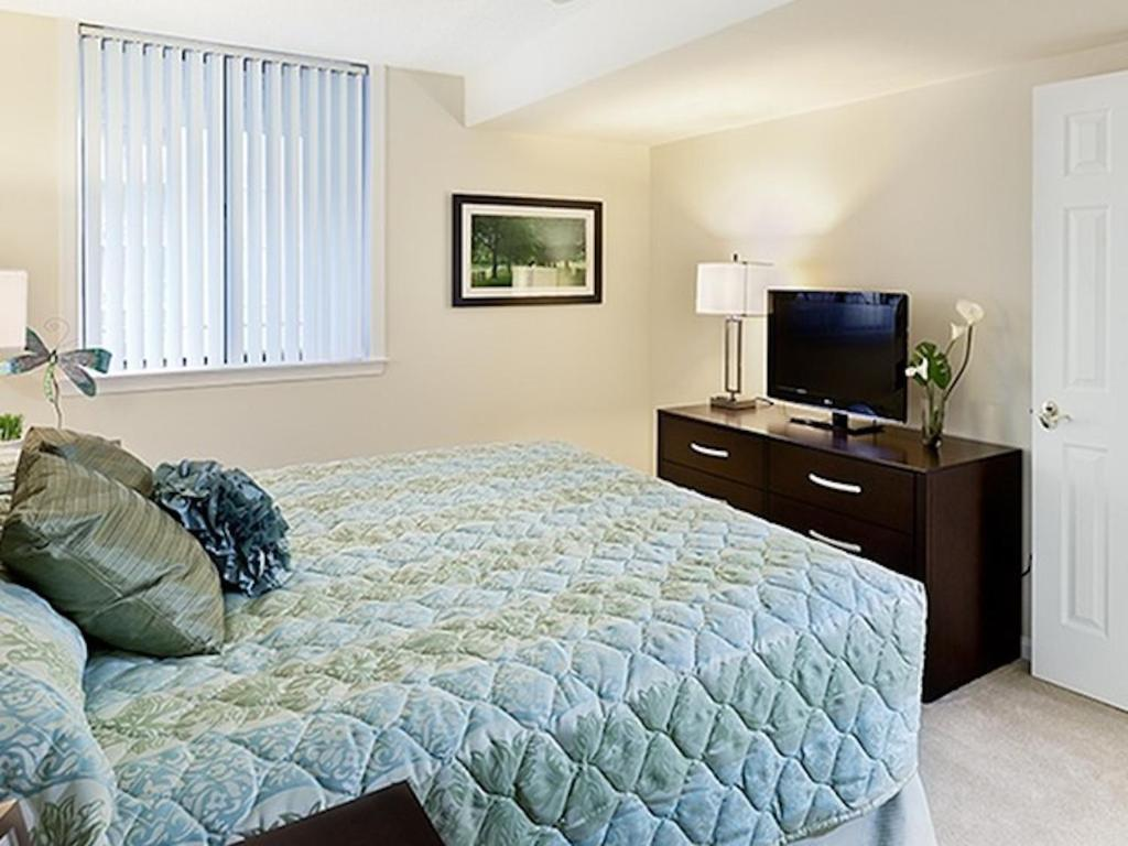 A bed or beds in a room at Court House Residences
