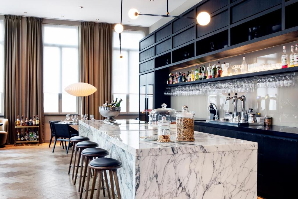 The lounge or bar area at Pillows Grand Boutique Hotel Place Rouppe Brussels