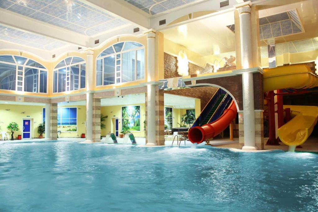 The swimming pool at or near Hotel Astral Complex A