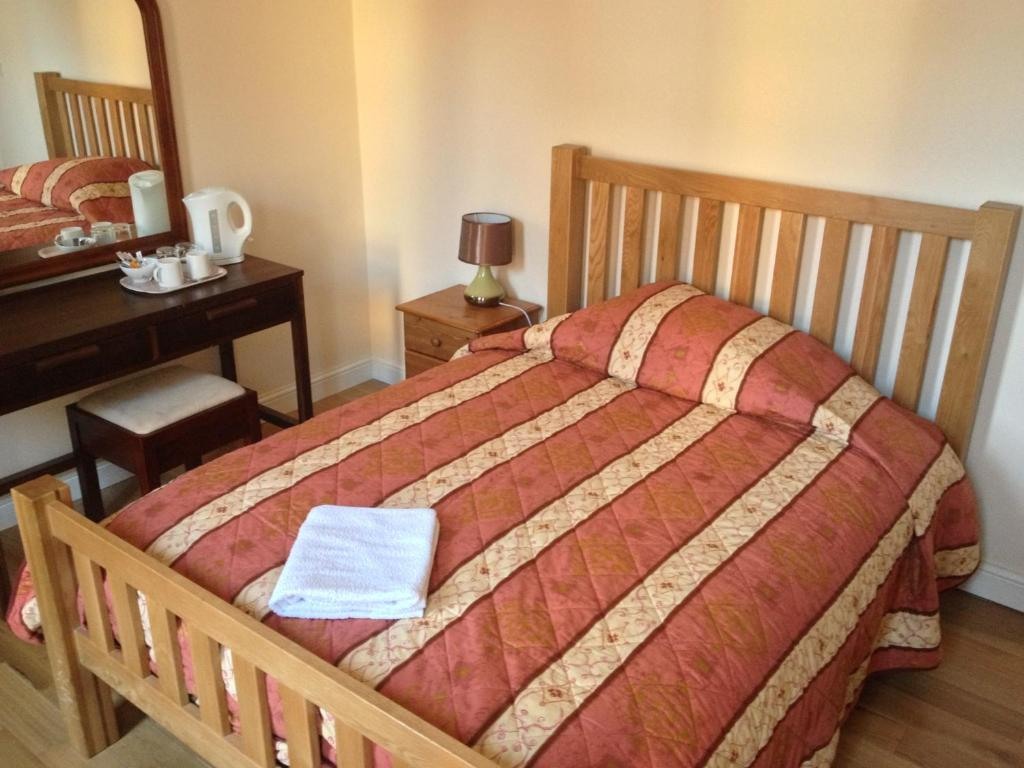A bed or beds in a room at The Dharma Lodge