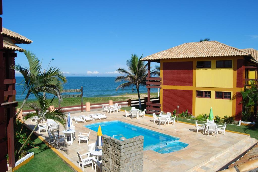 A view of the pool at Pousada Portal da Barra or nearby