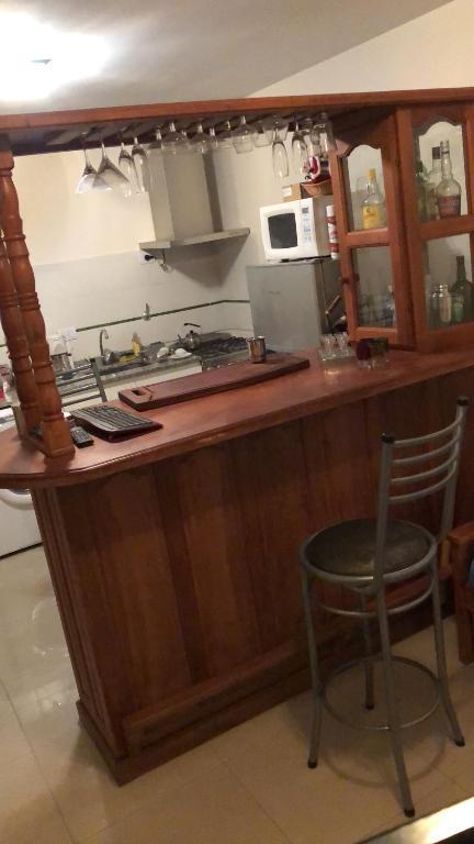 A kitchen or kitchenette at Departamento Oficina Relax
