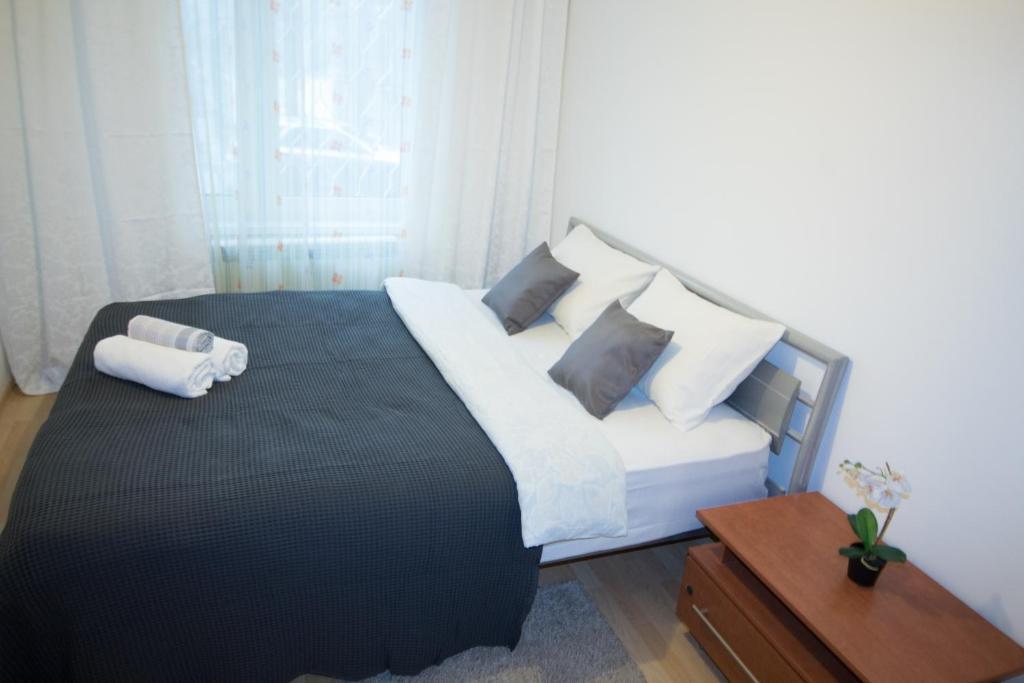 Кровать или кровати в номере Квартира на Орехово