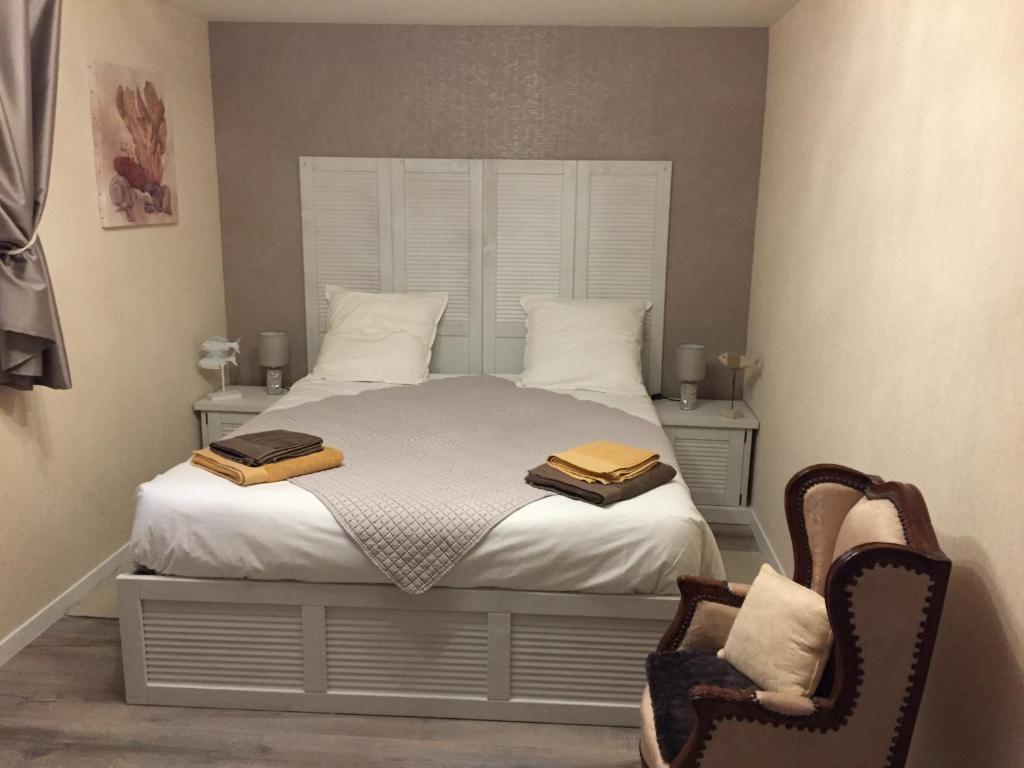 Un ou plusieurs lits dans un hébergement de l'établissement La Homardine