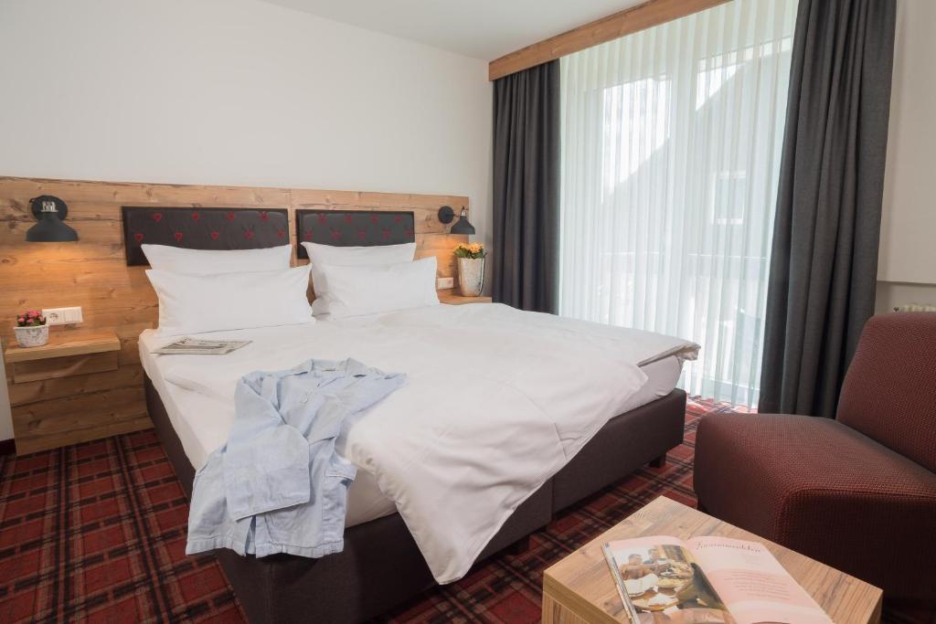 Ein Bett oder Betten in einem Zimmer der Unterkunft Hotel Kammerer