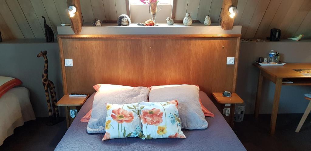 Un ou plusieurs lits dans un hébergement de l'établissement Au Bosquet Fleuri