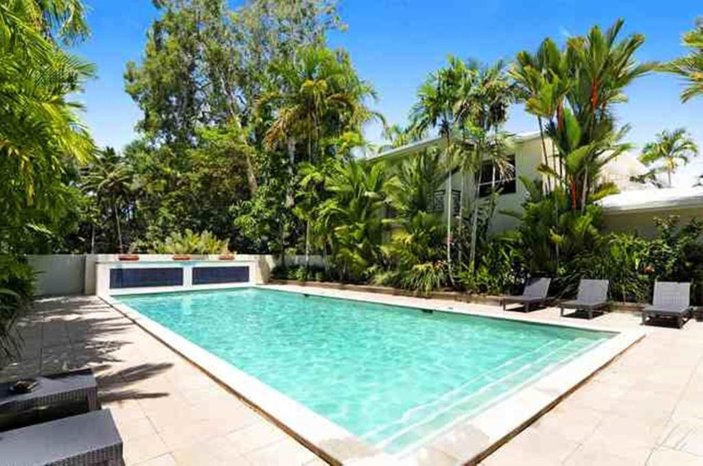 The swimming pool at or near Plantation House 1 Spacious 4 Bedroom House Near Beach WIFI Netflix Telstra TV Playground Pool BBQ